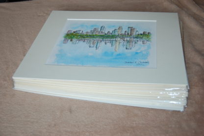Stack of matted skyline prints.