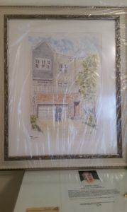 Large framed watercolor house portrait wrapped for a house warming gift.