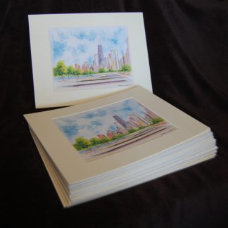 Stack of matted skyline prints for volume orders