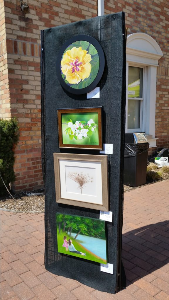 Artwork panel showcasing current works at May Fest. Photograph courtesy of Condren Galleries.
