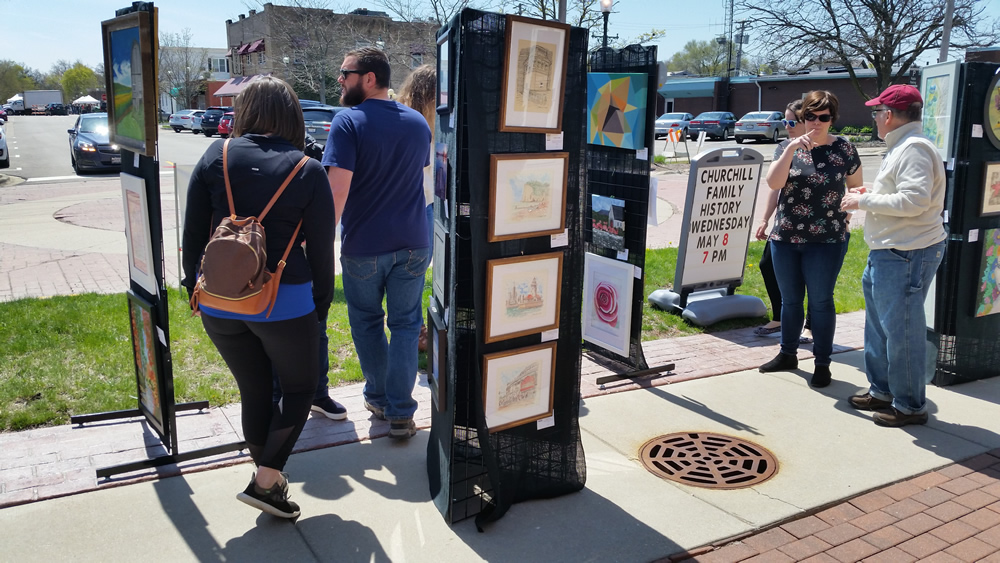 Artwork panels showcasing current works at May Fest.