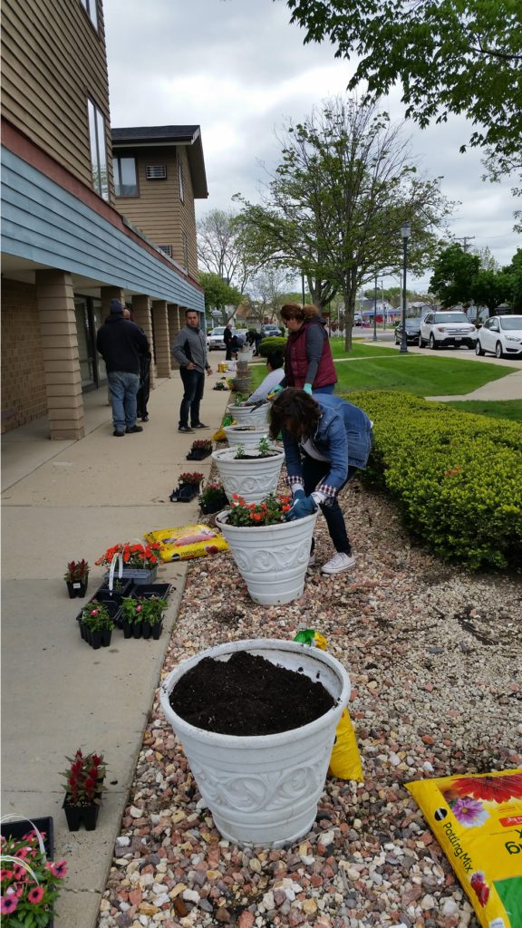Planting Flowers by Condren Galleries.