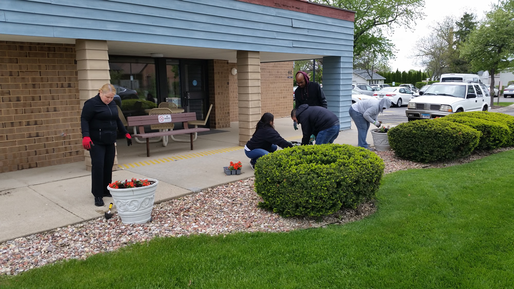 Lake County Housing Authority Planting Flowers.