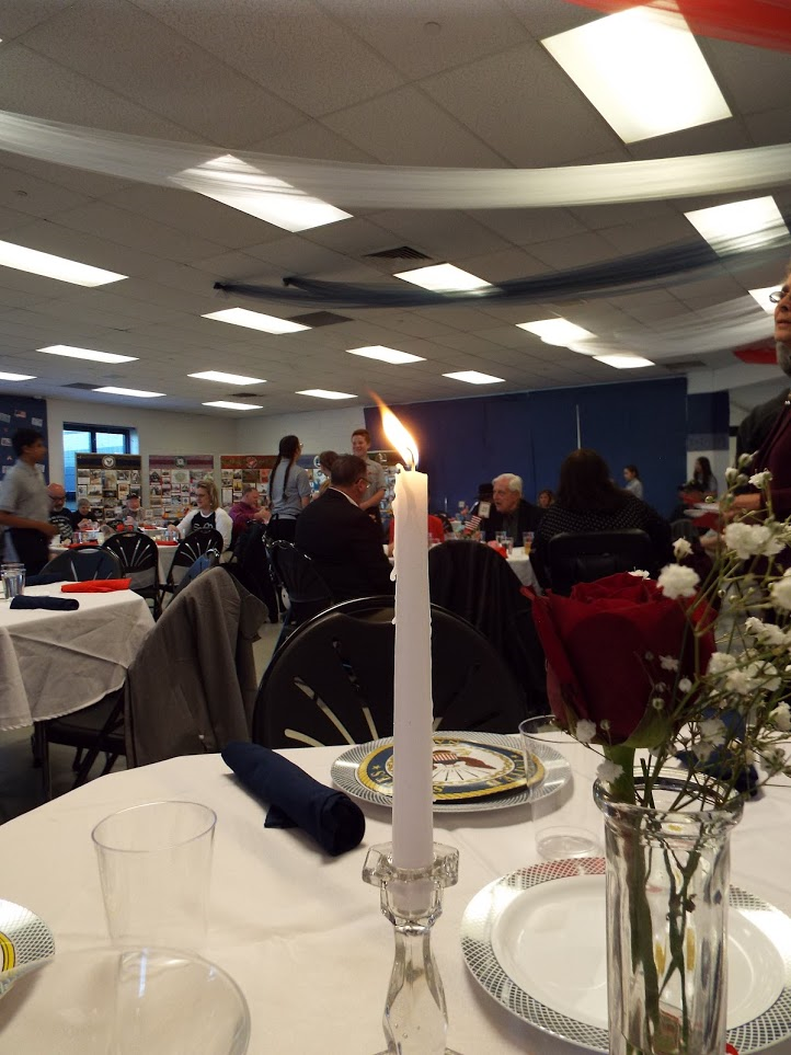 Candle burning in honor of lost Veterans at Mundein Veterans Dinner.