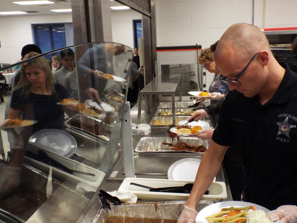 People being served at Mundelein Police Veterans Dinner.