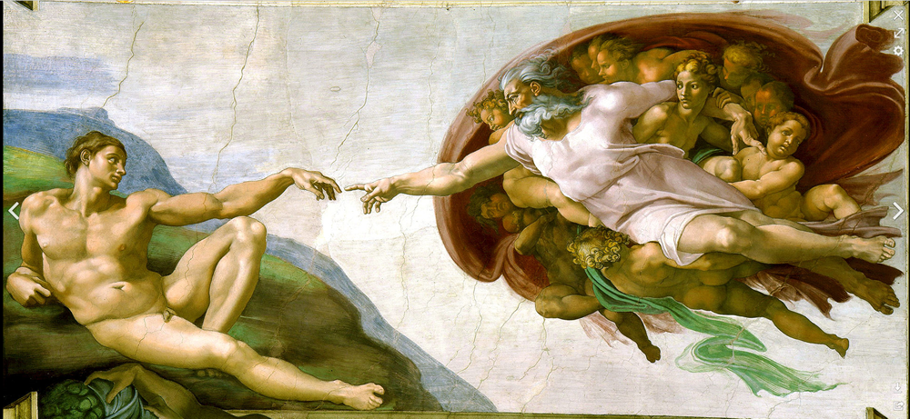 Photo of God creating Adam in the Sistine Chapel by artist Michelangelo.