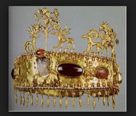 Gold diadem with precious jewels at Condren Galleries.